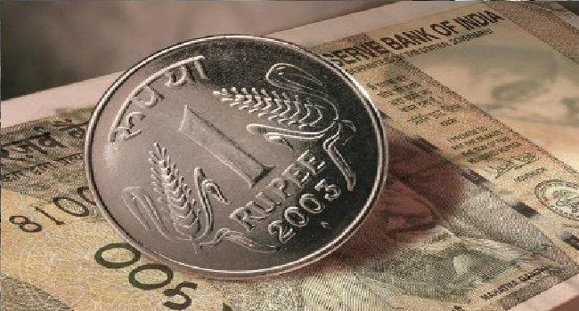 Rupee down eight paise against dollar at start of business