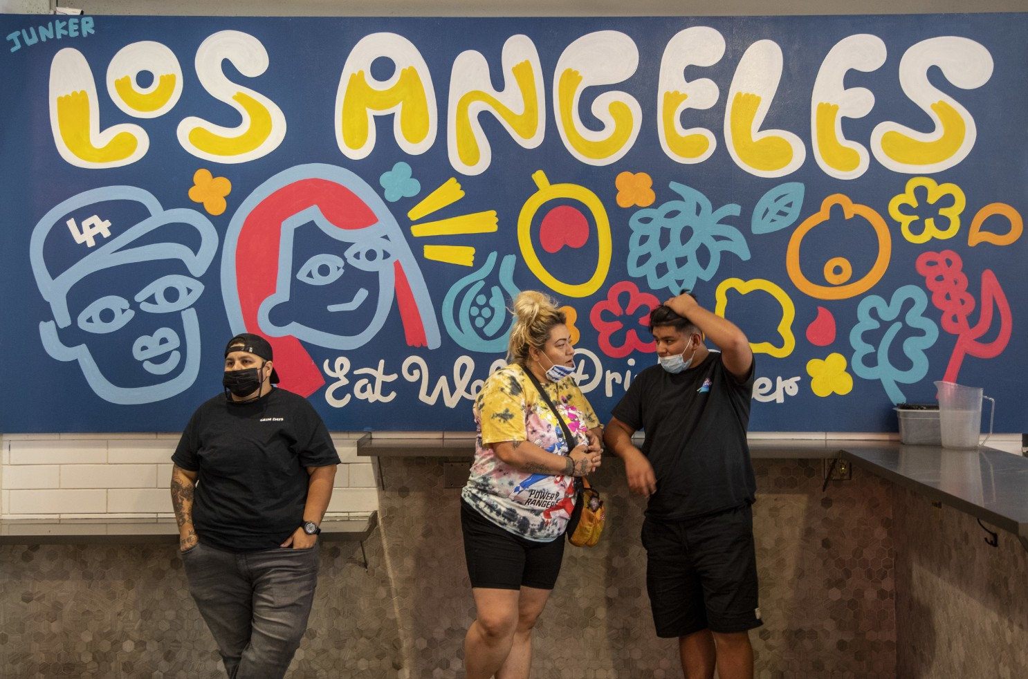 California officials urge people to wear masks inside closed spaces